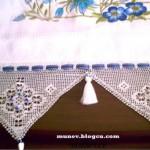 nazar boncuklarıyla süslenmiş üçgen havlu kenarı